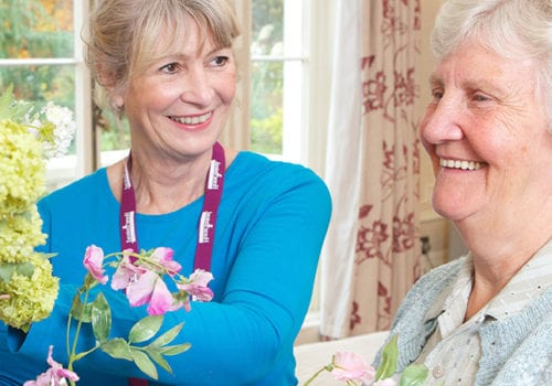 home instead truro elderly woman with her carer
