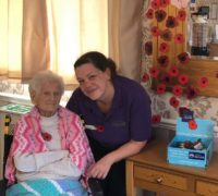 Broadacres Care Home resident Clarice Bloy and activities coordinator Jo MacGregor in front of the home's Remembrance Day display
