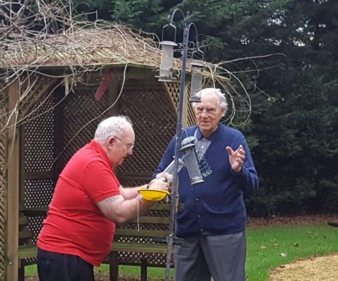 care home residents set up feeders for the big garden birdwatch