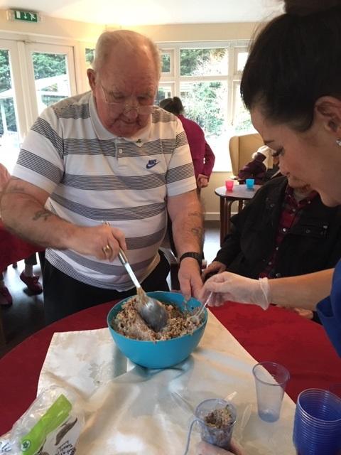 Aaron Grange resident mixing up some bird food