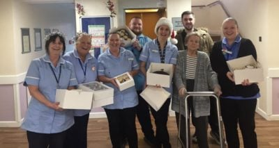 Aaron Court staff and residents with their prize cakes