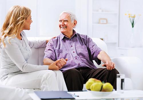 Elderly man with carer or family member