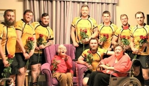 care home residents surprised by rose bearing rugby team