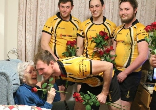 Resident gets a kiss from rugby player