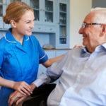 smiling elderly man and nurse