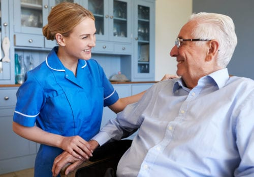 smiling elderly man and nurse