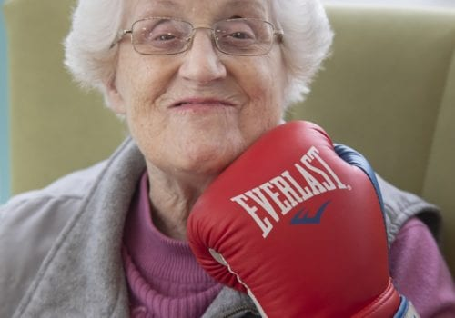 Resident Daphne Egan poses with boxing glove