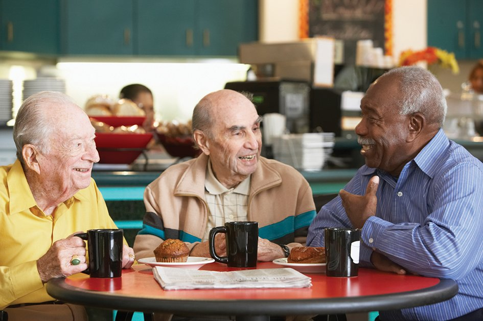 three elderly men laughing