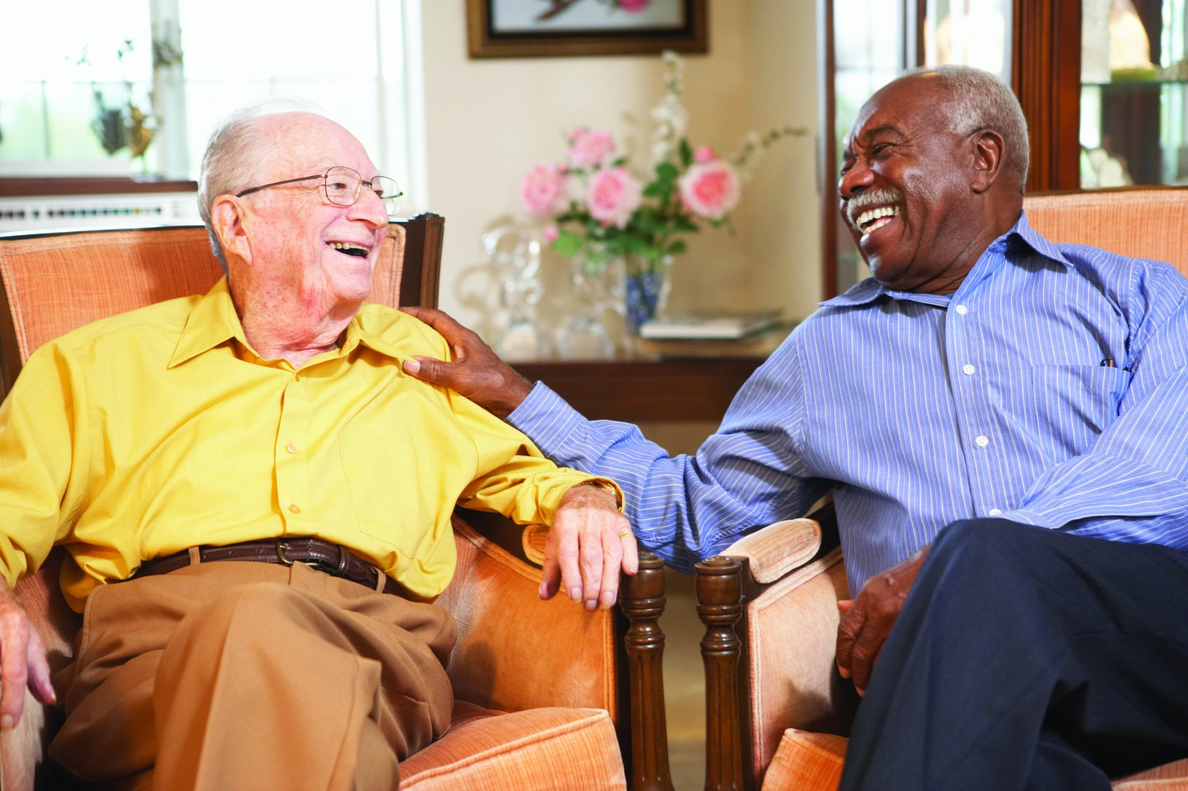 Two senior men laughing