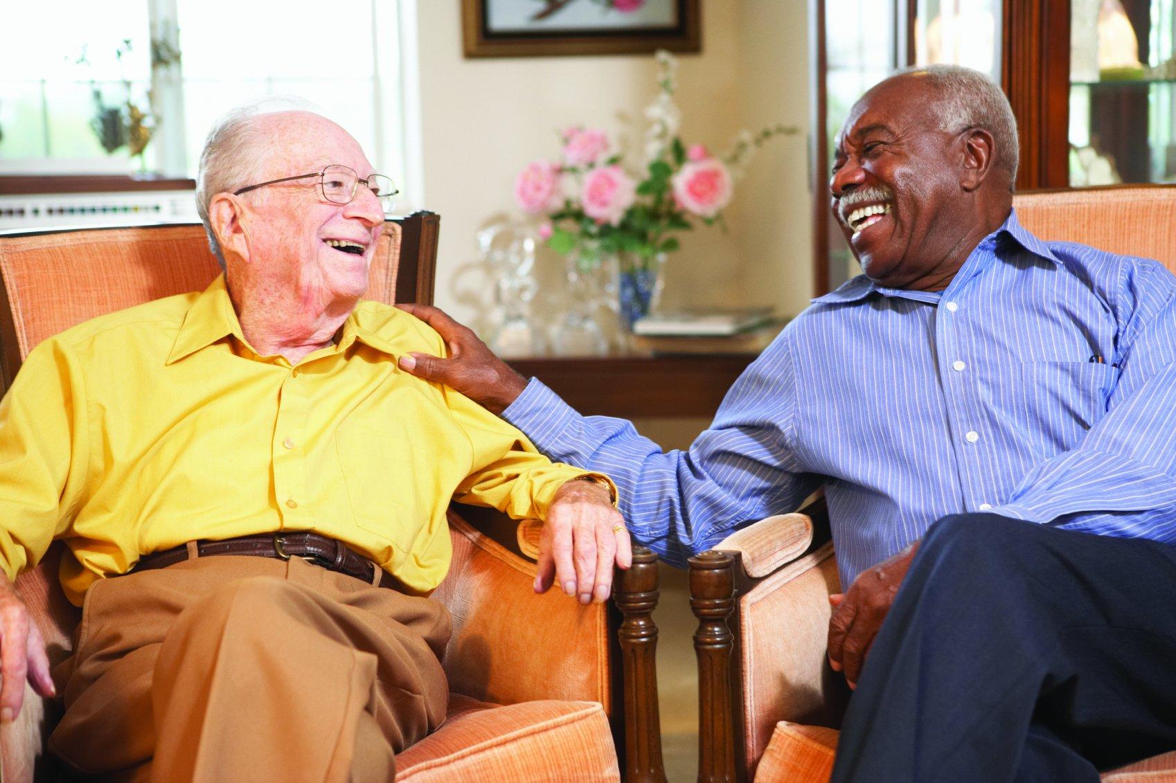 Two senior men laughing