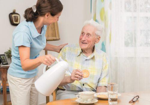 Mumby's Homecare carer and elderly man