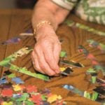 older lady doing a jigsaw puzzle