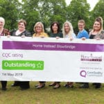 The Home Instead Stourbridge team with their outstanding sign