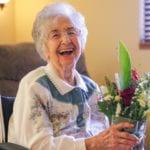 Elderly Lady with flower