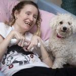 Pendine Park resident Lizzie Bennett and canine companion Daisy the Bichon Frise
