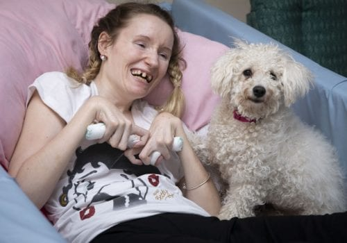 Pendine Park resident Lizzie Bennett and canine companion Daisy the Bichon Frise