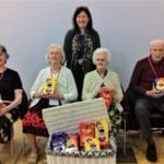 residents of simonsfield care hoe sit with their easter eggs after they were invited by local school to enjoy a special Easter assembly