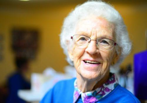 elderly lady in blue smiling