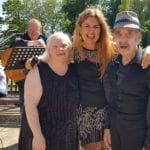 Waverley Lodge Care Home resident Jillian Gallagher, singer Christina Rosemont and resident Matty Ovington enjoying the summer sunshine with a mini-festival in the garden.