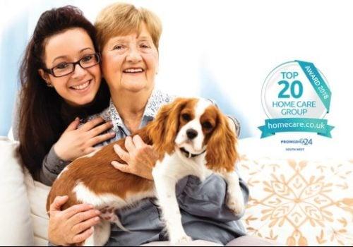 older lady, carer and dog