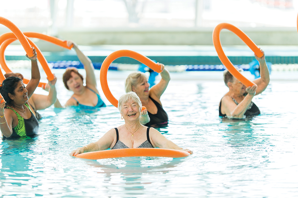 Group of women doing water aerobics.