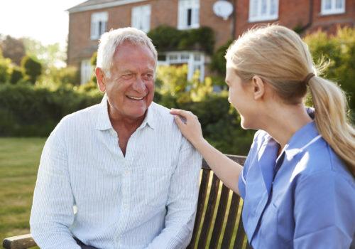 nurse talking to senior man