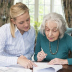 Professional helping older lady with estate planning