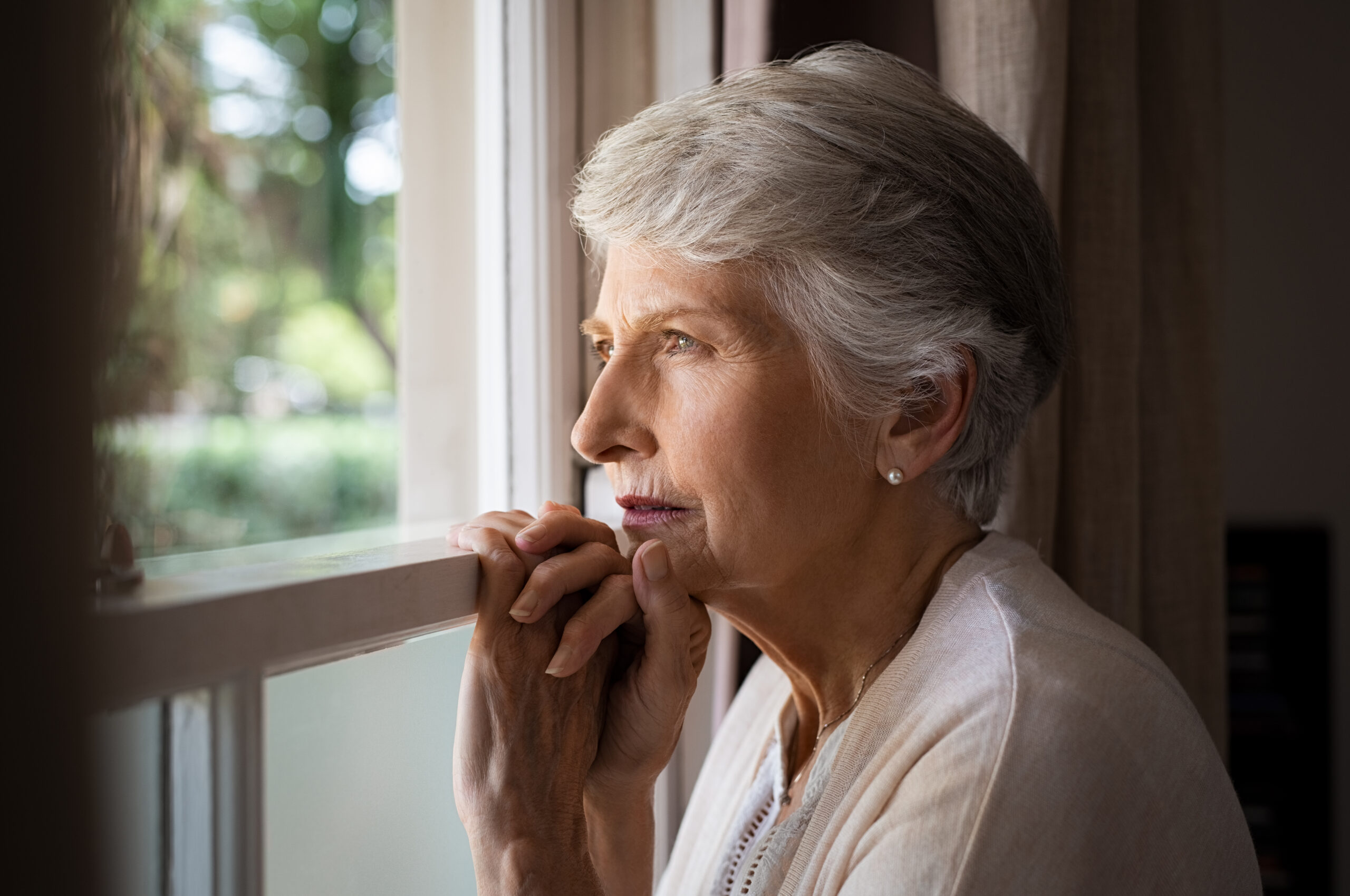 Older lady looking out of window
