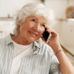 older smiling lady on phone